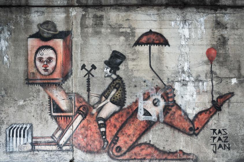 Weird mural of Man riding robot