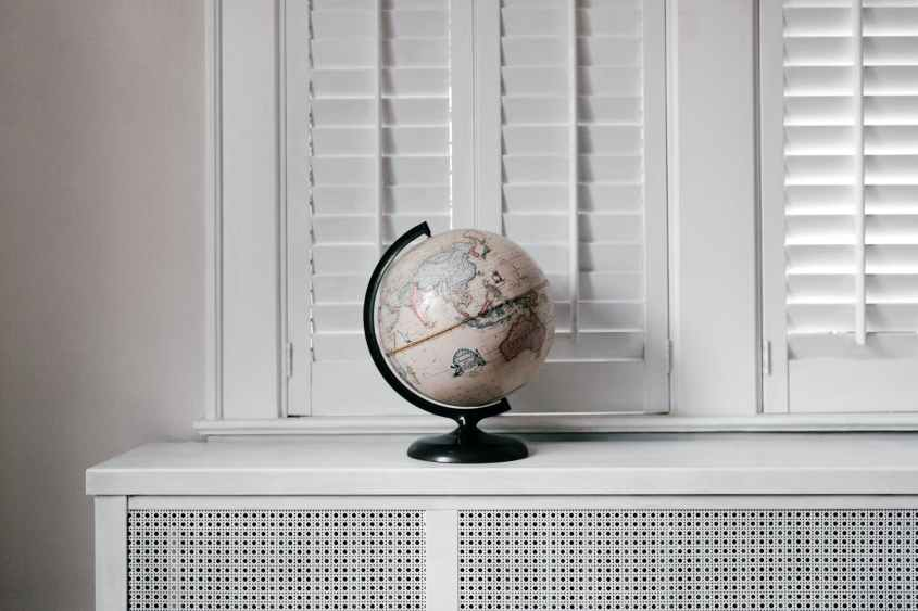 white and black desk globe